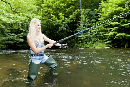 woman fishing in river Stock Photo - 8133802