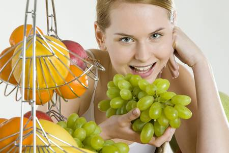 woman during breakfast with fruit photo
