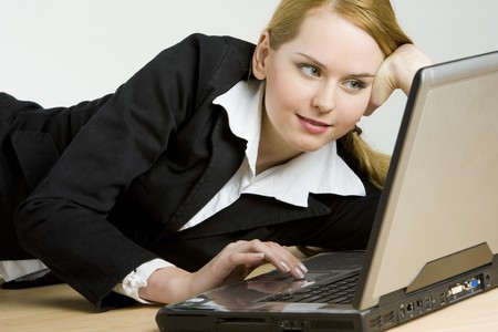 lying businesswoman with a notebook photo