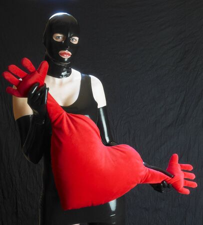 extravagancy: woman in latex with heart