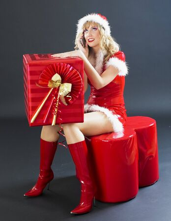 calling Santa Claus with Christmas present Stock Photo - 8217730