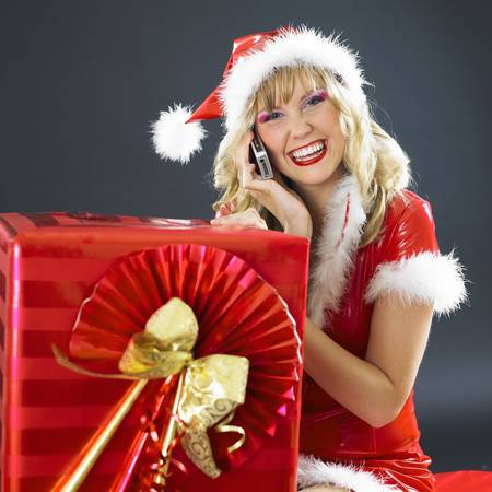 festival moments: calling Santa Claus with Christmas present Stock Photo