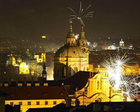 St. Nicholas church at night, New Years Eve in Prague, Czech Republic photo