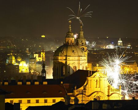 St. Nicholas church at night, New Years Eve in Prague, Czech Republic photo