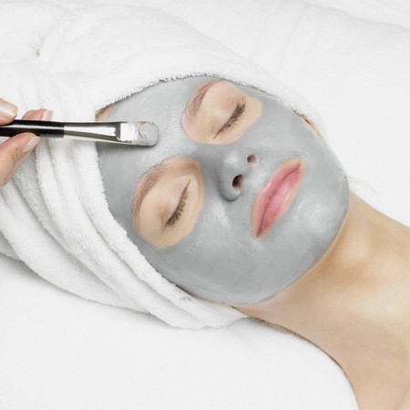 hand towel: woman with facial mask Stock Photo
