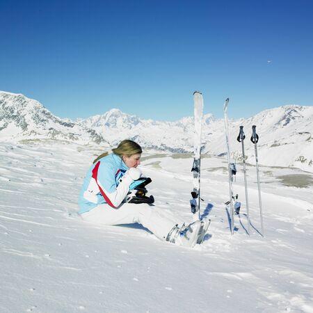 woman skier, Alps Mountains, Savoie, France photo