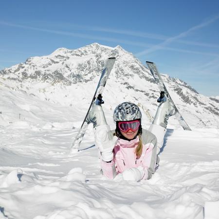 ski resort: woman skier, Alps Mountains, Savoie, France Stock Photo
