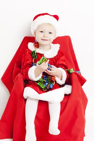 little girl as Santa Claus with Christmas chain photo