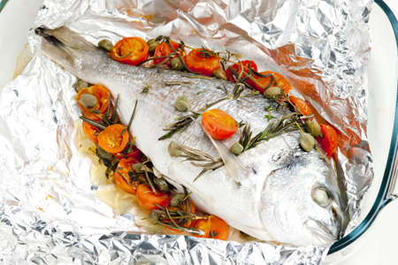 still lifes: bream baked with herbs and cherry tomatoes