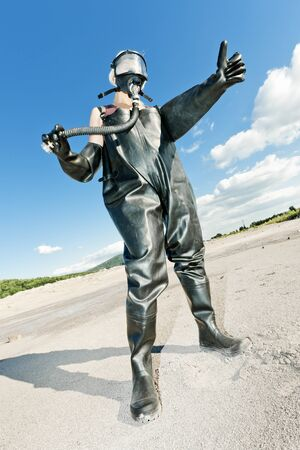 gasmask: standing woman with gas mask wearing protective clothes Stock Photo
