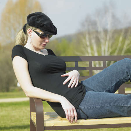 mammas: pregnat woman in park (the 5th month)
