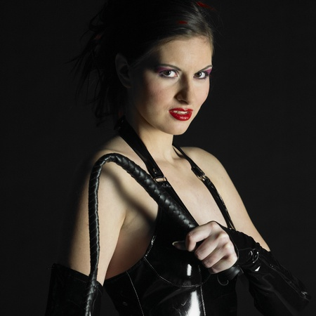woman in latex with whip Stock Photo
