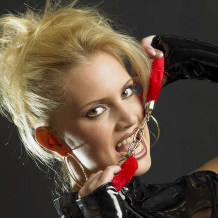 latex fetish: womans portrait with handcuffs