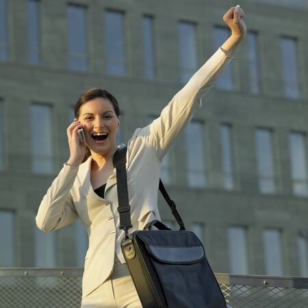 telephoning: telephoning businesswoman with a laptop