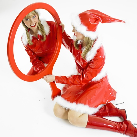 festival moments: Santa Claus with a mirror Stock Photo