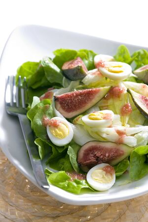 still lifes: salad with figs and quail eggs