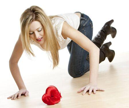 kneeling woman with heart photo