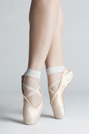 detail of ballet dancers feet photo