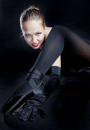 portrait of ballet dancer in black clothes photo
