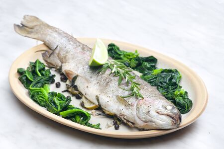 bream baked with Italian herbs and fried spinach photo