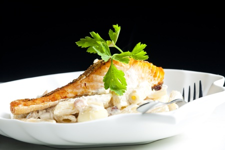baked salmon on pepper with creamy pasta photo