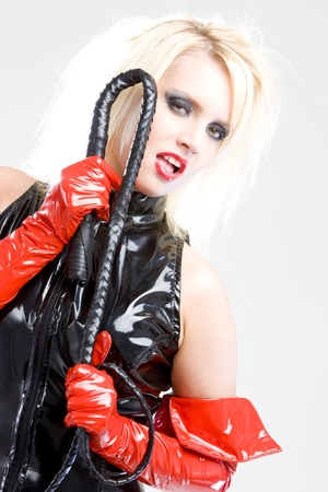woman in latex with whip Stock Photo - 8952786