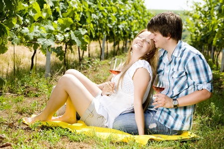 gladly: couple at a picnic in vineyard