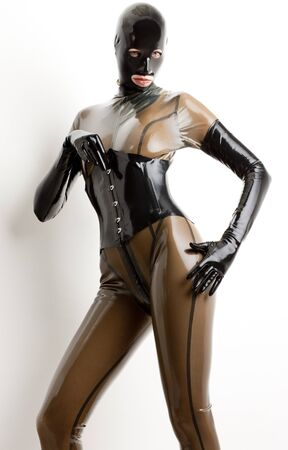 extravagancy: portrait of standing woman wearing latex clothes