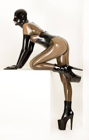 kneeling woman wearing latex clothes photo