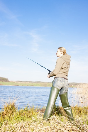 woman fishing at a pond Stock Photo - 9018298