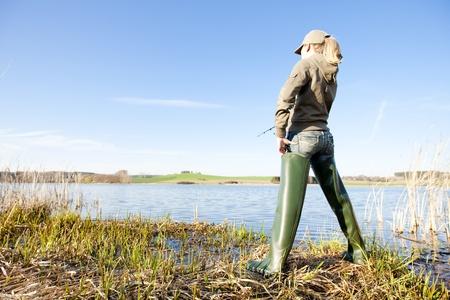 woman fishing at a pond photo