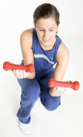dumb bells: woman exercising with dumb bells