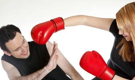 dark haired woman: couple with boxing gloves