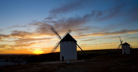 auroral: windmills at sunset, Campo de Criptana, Castile-La Mancha, Spain