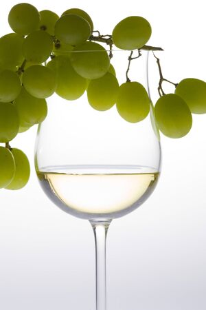 wineglass with white wine and grape Stock Photo - 9351397