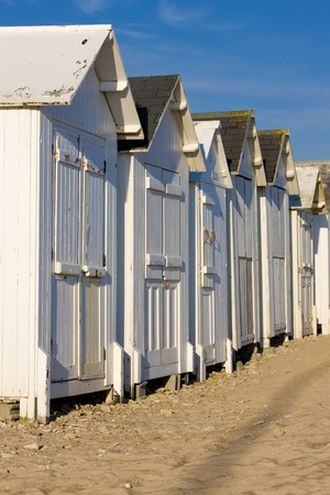 huts: huts on the beach, Bernieres-s-Mer, Normandy, France Stock Photo