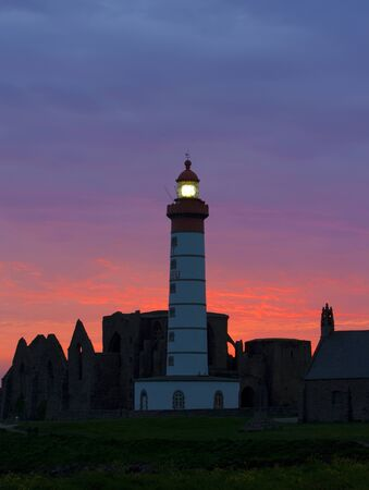 lighthouse and ruins of monastery, Pointe de Saint Mathieu, Brittany, France photo