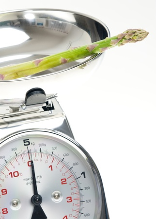 green asparagus on kitchen scales photo
