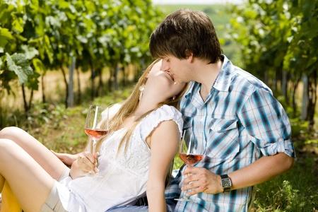 kisses: couple at a picnic in vineyard
