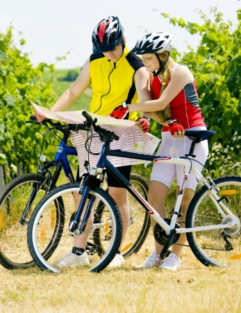 bicyclists: bikers holding a map in vineyard, Czech Republic