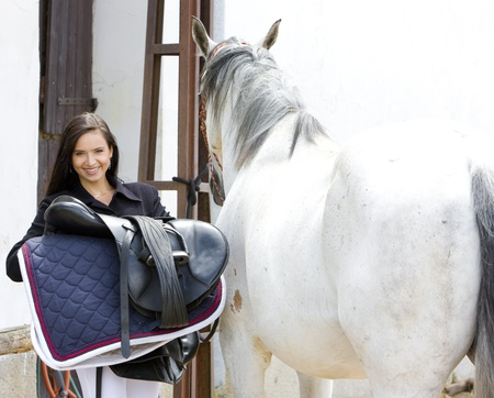 equestrian with horse photo