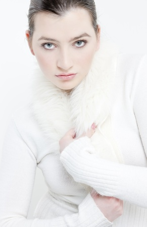 pullovers: portrait of young woman wearing white sweater Stock Photo