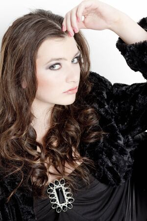 portrait of young woman wearing black clothes photo