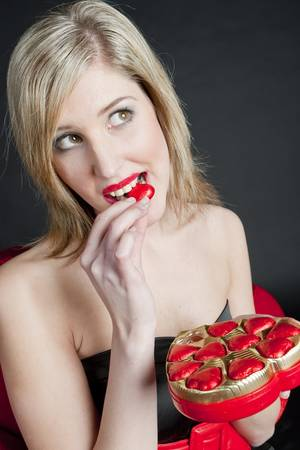 portrait of young woman with Valentine�s chocolate box photo
