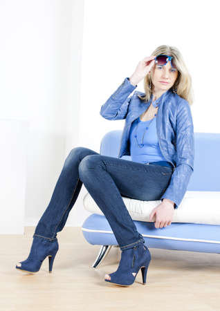 woman wearing blue clothes sitting on sofa Stock Photo - 9619831