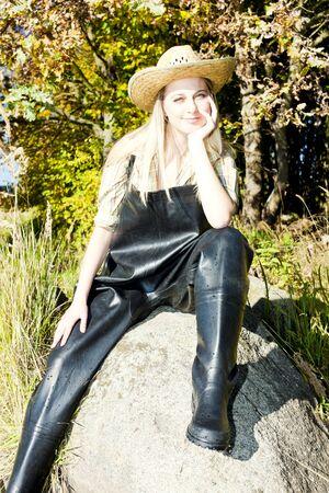 fisher woman sitting on stone photo