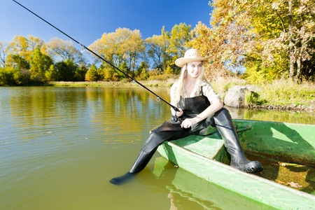 fishing woman sitting on boat Stock Photo - 9619859