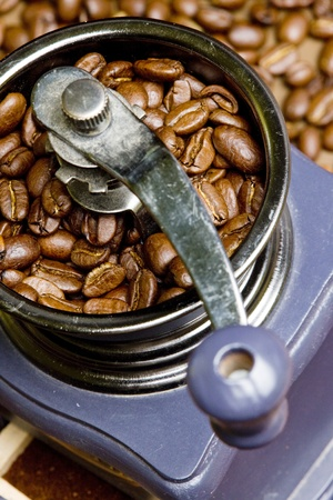 still lifes: detail of coffee mill with coffee beans
