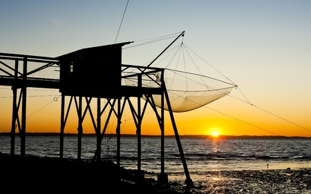 gironde department: pier with fishing net during sunrise, Gironde Department, Aquitaine, France Stock Photo