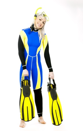 flippers: standing young woman wearing neoprene with snorkeling equipment